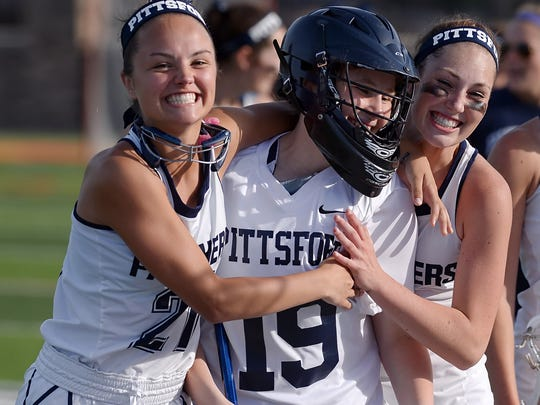 Pittsford's Alex Pound, left, Michelle Messenger and Meghan Doyle celebrate their win in the Section V Class A championship at St. John Fisher College in 2016 when they were sophomores.