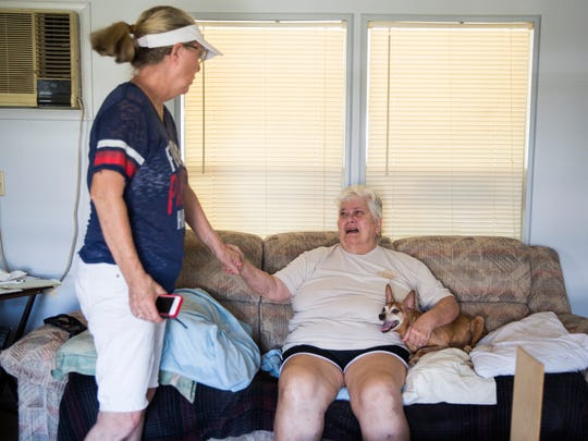 While assessing their property damage caused by Hurricane Irma, Carol Sykora, right, became emotional as her neighbor Linda Beale provided comfort in Plantation Island, an unincorporated area nearby Everglades City on Tuesday, September 12, 2017.