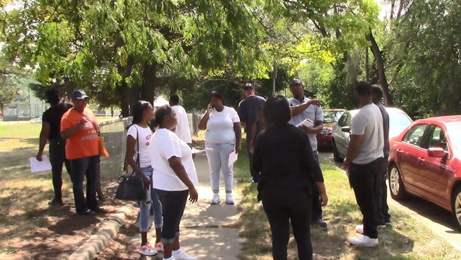 Friends and family of slain high school football star Allantae Powell pass out fliers seeking answers about the 2011 drive-by shooting.