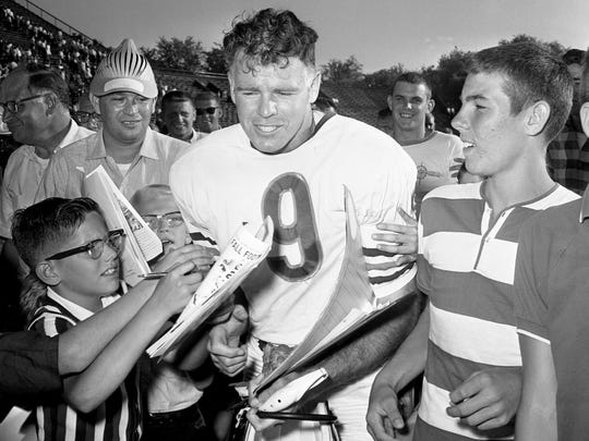 A mob of autograph-seeking youngsters corner Bill Wade after the former Vanderbilt great starred in the Bears' 28-14 preseason victory over the Rams at Dudley Field on Aug. 28, 1965.