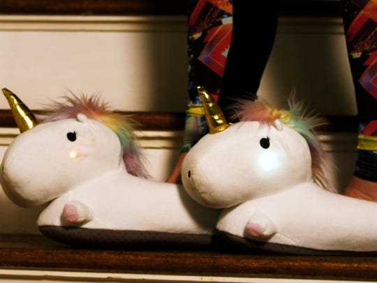 Adorable unicorn slippers ($39.99) for any lady in