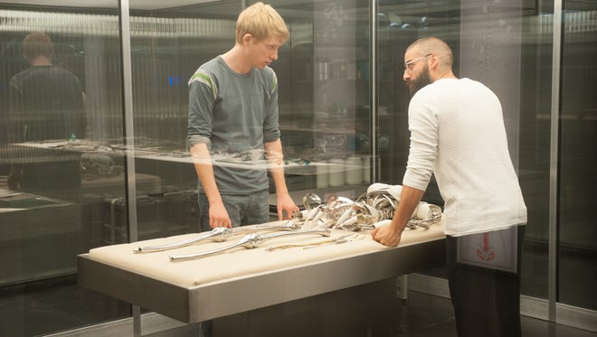 "Domhnall Gleeson, left, and Oscar Isaac in a scene from ""Ex Machina."""