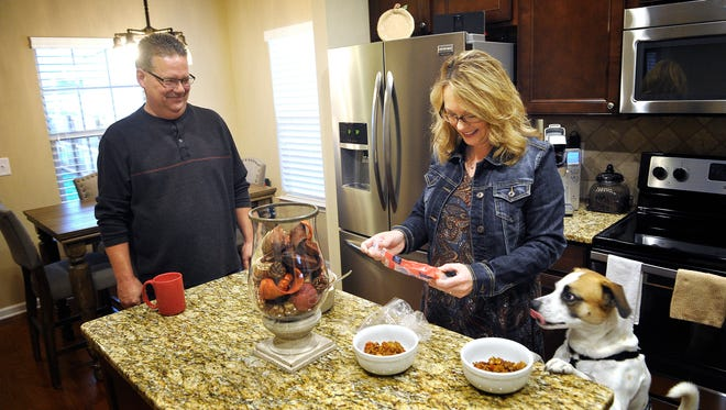 Deanna and Ron Damesworth prepare lunch with their dog Gizmo keenly aware of what is happening. The Damesworths have downsized from a larger home in Spring Hill and they now love the sense of community in their new neighborhood at Arden Village in Maury County.