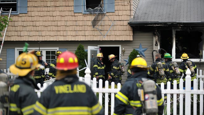 Vineland firefighters respond to a house fire on High Ridge Road on Monday.