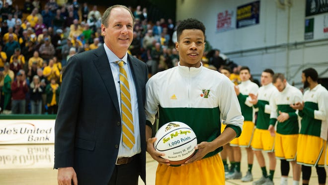 Catamounts guard Trae Bell-Haynes (2) is presented with a ball honoring his 1,000th point during the men's basketball game between the New Hampshire Wildcats and the Vermont Catamounts at Patrick Gym on Feb. 9.
