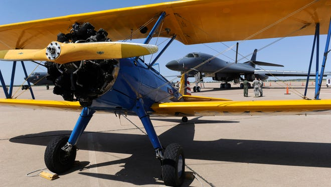 A Stearman PT-17 stands before a B-1 and a B-52 bomber Friday, Sept. 8, 2017, at Dyess Air Force Base. On Friday, the base celebrated the 100th anniversary of the 9th Bomb Squadron, the 28th Bomb Squadron, and the 436th Training Squadron.