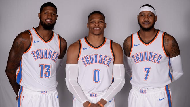 Oklahoma City Thunder forward Paul George (13), guard Russell Westbrook (0) and forward Carmelo Anthony (7)  pose for photos during the Oklahoma City Thunder Media Day at Chesapeake Energy Arena.