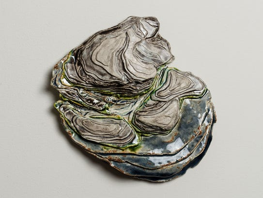 """""""Ravine,"""" a glazed earthenware paperclay relief sculpture"""
