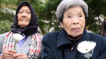 Estelita B. Dy, a former Philipine comfort woman, and Cheng Chen-tao, a former comfort woman from Taiwan, commemorate others during an observance Dec. 10 in Taipei, Taiwan. Reactions to the deal were mixed.