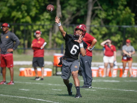 Iowa State freshman quarterback Re-al Mitchell fires a pass during open practice on Aug. 3, 2018, at Iowa State in Ames.