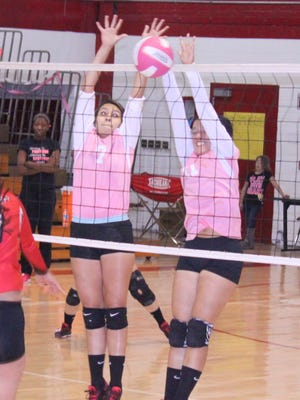 Cobre's Angel Holguin, left, and Brandy Hernandez combine for a block during action against Hatch Valley on Tuesday night in Bayard.