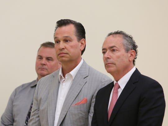 Richard Brega, center, faces federal charges of bribery. In this photo, he's standing with his attorney Kerry Lawrence, right, in Rockland County Court, where he will face separate corruption charges. Rockland District Attorney's Office Detective Cyril Kerr stands behind Brega.