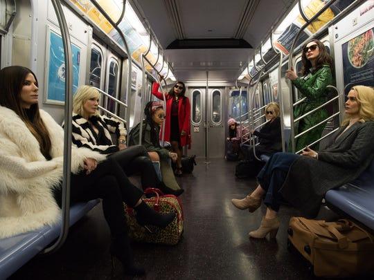 "Sandra Bullock (from left), Cate Blanchett, Rihanna, Mindy Kaling, Awkwafina, Helena Bonham Carter, Anne Hathaway and Sarah Paulson star in ""Ocean's 8."""