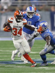 Detroit Lions' Tahir Whitehead tackles the Cleveland