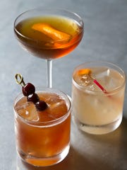 Pascal and Sabine offer old school drinks. Bartender Beth Twaddell mixes them up.Clockwise from top, Pascal's Manhattan, French Blonde, and a Blood & Sand. Asbury Park, NJ Tuesday, June 17, 2014 Doug Hood