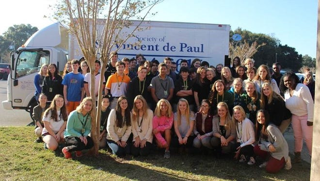 Pensacola Catholic High School students and faculty collected more than 29,000 food items for area food banks.