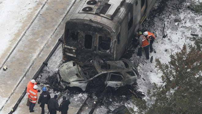 Aerial views of the Metro North train accident at the Commerce Street crossing in Valhalla on Feb. 4, the day after the crash that killed five men aboard the commuter train and the driver of an SUV on the tracks.
