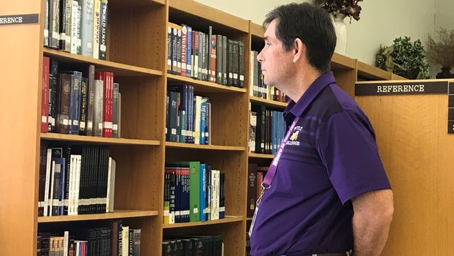 Wylie High School Principal Tommy Vaughn listens to a presentation on school safety Friday afternoon. Vaughn was forced to tackle an unarmed youth who Friday morning attempted to enter the school without permission.