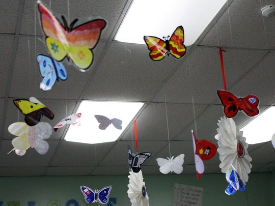 Fifth graders at Central School decorated and hung colorful butterflies as part of a language arts unit that used a book of poetry written by children interned in the Terezin concentration camp during World War II.
