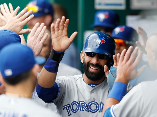 Toronto Blue Jays' Jose Bautista reacts after scoring with bases loaded in the sixth inning of a baseball game against the Kansas City Royals at Kauffman Stadium in Kansas City, Mo., Sunday, June 25, 2017. Will he do one of his famous bat flips on Monday for Gwinnett in a double-header against Red Wings at Frontier Field?