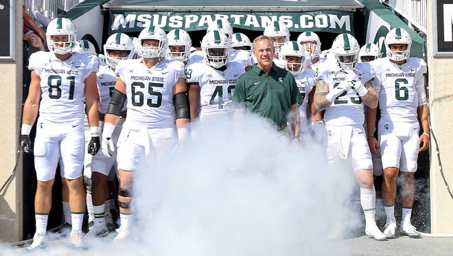 Sep 9, 2017; East Lansing, MI, USA; Michigan State head coach Mark Dantonio leads his team onto the field prior to a game against Western Michigan at Spartan Stadium.