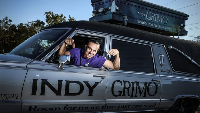 Jose Garcia poses for a portrait in a 1992 Cadillac hearse-turned-limousine, available from Indy Grimo, seen in Indianapolis, Monday, Oct. 9, 2017. Indy Grimo offers year-round rides in two hearses and a party bus. The pictured Cadillac seats six, and a stretched Ford Explorer family coach seats 10.
