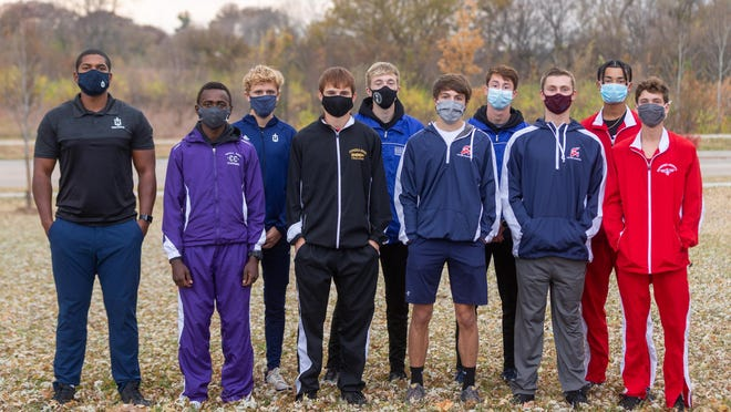 The 2020 All-City boys cross country team members are, from left, coach DeJuan Gardenhire, Lenny Njoroge, Addison Sigg, Jace Moore, Corbin Atkins, Jackson Esquibel; back row, Tanner Newkirk, Arrik White, Jacob Mitchell and Kory Sutton.
