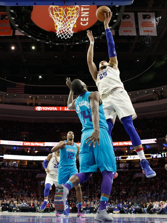 Philadelphia 76ers' Ben Simmons, right, shoots over Charlotte Hornets' Michael Kidd-Gilchrist during the first half of an NBA basketball game Friday, March 2, 2018, in Philadelphia. (AP Photo/Chris Szagola)