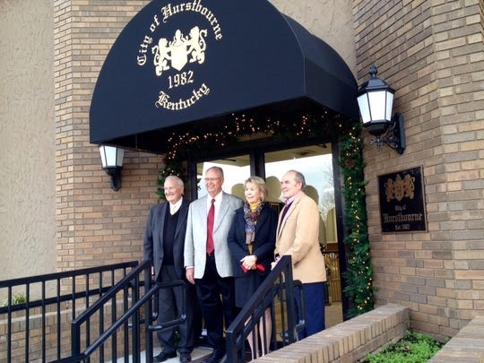 Hurstbourne Mayor Mary Schneider joins three past mayors of Hurstbourne at the entrance to the new city hall building, 200 Whittington Parkway.  From left, they are Robert English, David Beckman and Bill Bardenwerper.