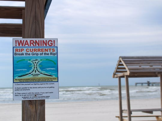 A sign at Padre Balli Park warns of rip currents in the Gulf.