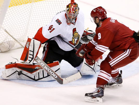 Ottawa Senators' Craig Anderson (41) makes a save on a shot by Arizona Coyotes' Sam Gagner (9) during the second period of an NHL hockey game Saturday, Jan. 10, 2015, in Glendale, Ariz.  (AP Photo/Ross D. Franklin)