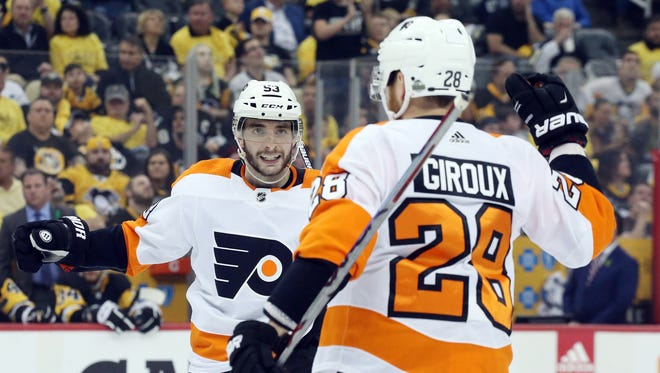 Philadelphia Flyers defenseman Shayne Gostisbehere (53) celebrates his goal with center Claude Giroux (28) against the Pittsburgh Penguins.