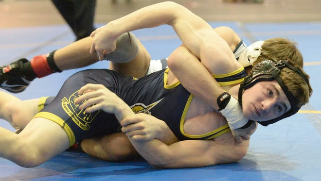 Holy Spirit's Dominic Sacco attempts to get out of a hold by Pope John's Kaya Sement  in the 126-lb bout of Sunday's NJSIAA Non-Public B Championship at Toms River North High School.