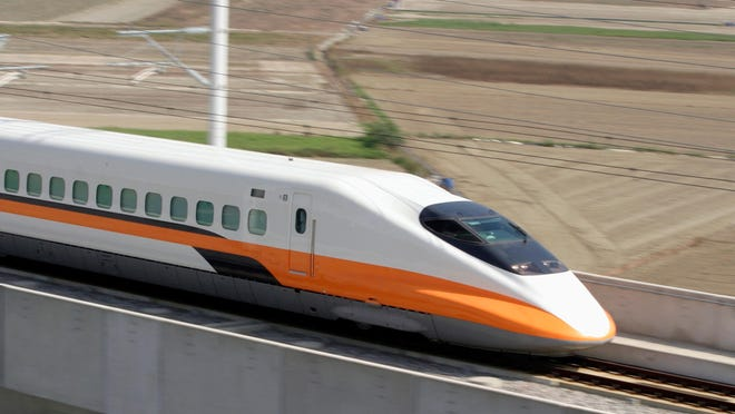 Taiwan' s high-speed train clocks 300km/hour during a test run, Sunday, Nov. 6, 2005, in Taiwan's southern county of Tainan.