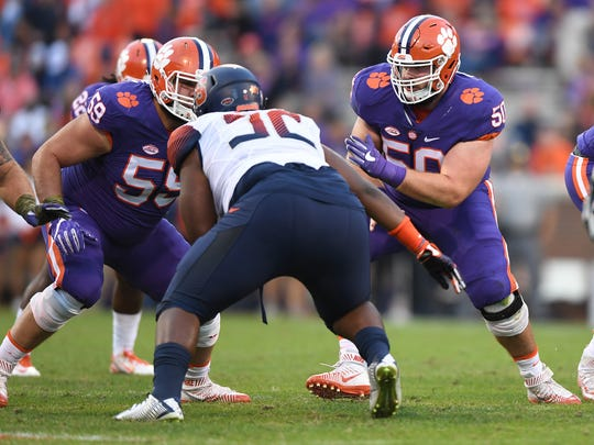 Clemson offensive linemen Gage Cervenka (59) and Justin Falcinelli (50) block during the fourth quarter on Nov. 5, 2016 at Clemson's Memorial Stadium.