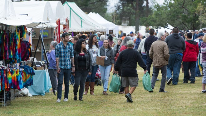 Renaissance ArtsFaire attendees, walk through the marketplace set up at the Renaissance Faire at Young Park , Saturday November 5, 2016.