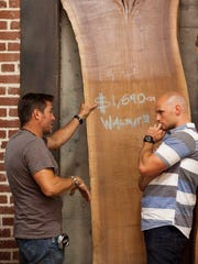 """Designer Tim McClellan (left) and his lead carpenter Chip Wade (right) look at wood options for Tim's dining table on """"Ellen's Design Challenge."""""""