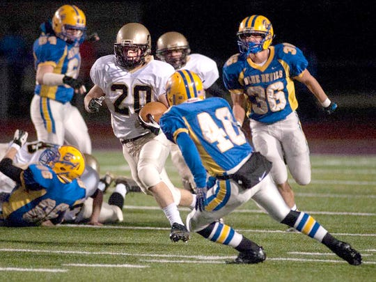 Delone Catholic's Lance Reneker looks for running room against Bellwood-Antis on Friday night at Mansion Park in Altoona. The Squires lost, 33-26, in double OT. (The Evening Sun -- Clare Becker)