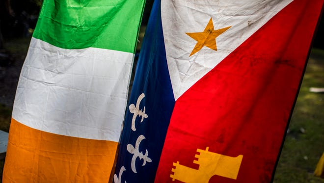 The festival unites the Irish and the Acadian flags.