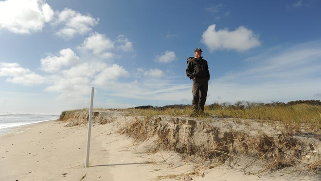 Chincoteague National Wildlife Refuge Manager Kevin Sloan stands on top of a sand dune at the refuge.