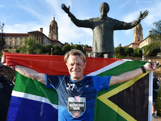 British comedian Eddie Izzard holds a South African