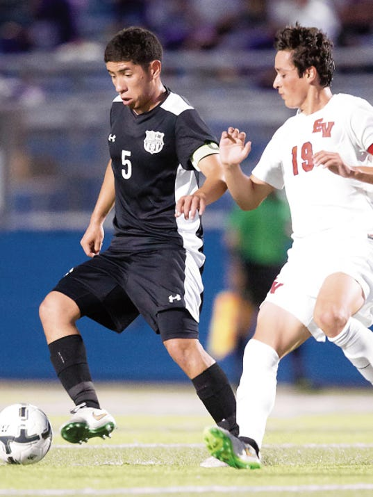 El Paso Horizon's Miguel Rivera battles with a Georgetown East View Patriot during Thursday evenings state 5A semifinal match in Georgetown, Texas.