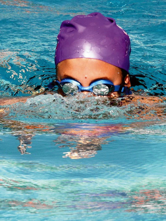 Bill Armendariz - Headlight Photo   Deming Dolphin Carlie Paulk poked her head above water during a heated battle in the individual  medely race on Saturday. Paulk was in the middle of her breaststroke lap.