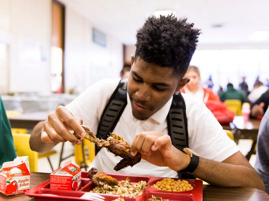 K'Vahn Mouton eats roasted chicken raised on campus at Acadiana High School in Lafayette March 3, 2016. Students have been raising chickens on the school farm with the help of a National Farm to School Grant and Initiative.