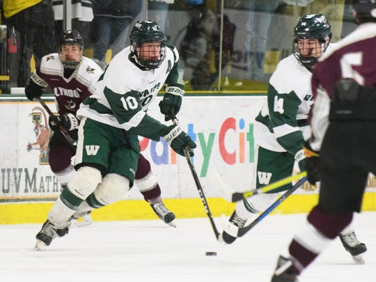 Woodstock's Steven Townley (10) skates with the puck during the Vermont state division II boys hockey championship game between Lyndon and Woodstock at Gutterson Field House on Monday evening March 19, 2018 in Burlington.