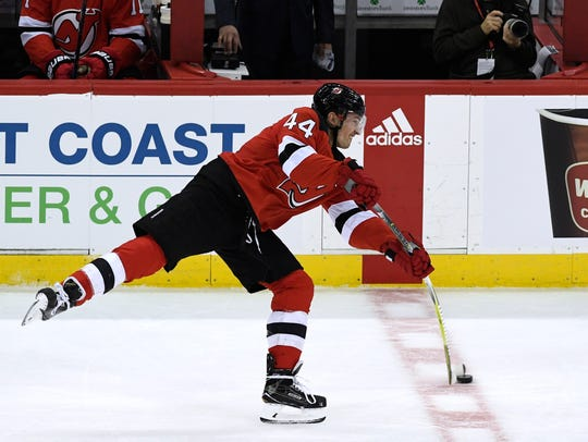 New Jersey Devils left wing Miles Wood (44) takes a