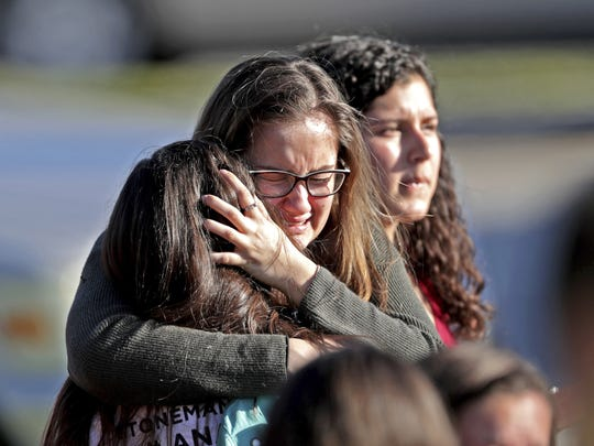 Students embrace after a shooting at Marjory Stoneman