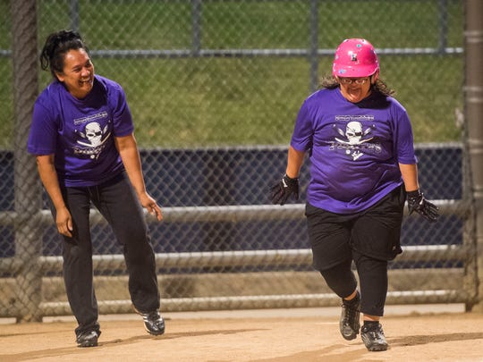 Kristi Ramos, right, celebrates with her mother Norma after after rounding the bases during a Fort Collins Unified softball game against the Sliders on Monday, June 12, 2018, at Rolland Moore Park in Fort Collins, Colo. Kristi ended up going two for two while wearing her new glasses, scoring on both attempts.
