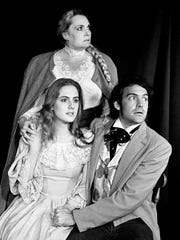 """The Bell family of Robertson County was terrorized by Kate, a ghost who came to be known as the """"Bell Witch."""" The legend is dramatized in """"Our Family Trouble: The Legend of the Bell Witch,"""" by the Actors' Playhouse. Posing for photo are Sue Thompson, standing, as Luce Bell, Betsy Bell is played by Liza Case with Lawrence McGuire as her friend Joshua Gardner."""
