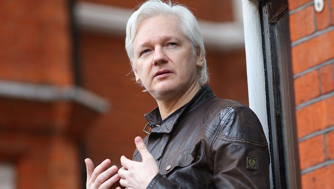 Julian Assange is pictured speaking to the media from the balcony of the Embassy Of Ecuador.